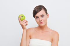 Girl with green apple. Royalty Free Stock Images