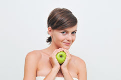 Girl with green apple. Stock Photos