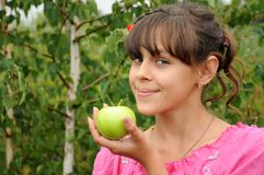 The girl with green apple Stock Photos