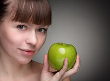 Girl with green apple Royalty Free Stock Photos