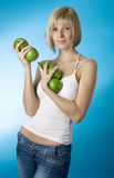 Girl with a green apple Stock Image