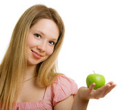 Girl with a green apple in her hand. Beautiful girl with a green apple in the hand Stock Images