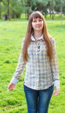 The girl on a green background. The girl poses on a green background of city park. 2013 Royalty Free Stock Photo