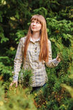 The girl on a green background. The girl poses on a green background of spring forest. 2013 Royalty Free Stock Images