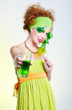 Girl with green beer Royalty Free Stock Images