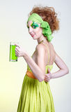 Girl with green beer Royalty Free Stock Photography