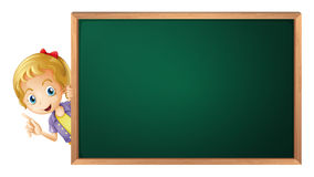 A girl and a green board Royalty Free Stock Photos