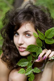 Girl with a green branch Royalty Free Stock Images