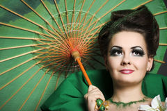 Girl in green with the Chinese umbrella Stock Images