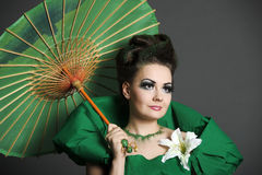 Girl in green with the Chinese umbrella Royalty Free Stock Image