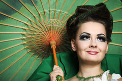 Girl in green with the Chinese umbrella Royalty Free Stock Images