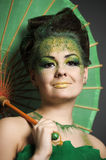 Girl in green with the Chinese umbrella Stock Photo