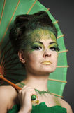 Girl in green with the Chinese umbrella Royalty Free Stock Photo