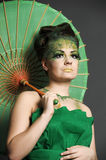 Girl in green with the Chinese umbrella Stock Photos