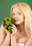 Girl with green chrysanthemum Stock Images