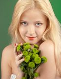 Girl with green chrysanthemum Stock Image