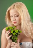 Girl with green chrysanthemum Stock Photos