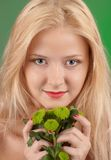 Girl with green chrysanthemum Royalty Free Stock Image