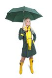 Girl  in green coat  with umbrella Stock Photo