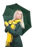 Girl  in green coat  with umbrella Royalty Free Stock Photography