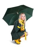 Girl  in green coat  with umbrella Royalty Free Stock Images