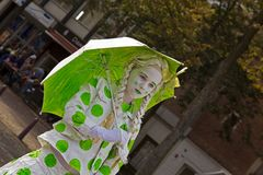 Girl in green dotted suit with umbrella during the world championships living statues in Arnhem Stock Images