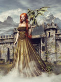 Girl with a green dragon. Young girl with a small green dragon standing in front of a fantasy castle Stock Photo