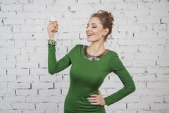 Girl in green dress with champagne Royalty Free Stock Photo