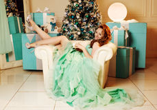 Girl in green dress with Christmas tree Royalty Free Stock Photo