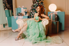Girl in green dress with Christmas tree Royalty Free Stock Photos