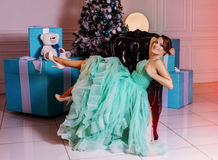 Girl in green dress with Christmas tree Royalty Free Stock Images