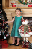 Girl in a green dress near a Christmas tree Royalty Free Stock Images