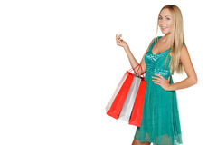Girl in green dress with packages Stock Photos