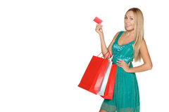 Girl in green dress with packages Royalty Free Stock Photo