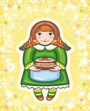 Girl in a green dress with a pie Royalty Free Stock Photos