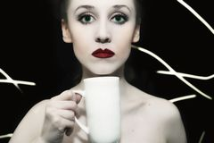 Girl with green eyes and red lips stock image