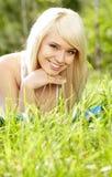 Girl on green field Stock Photo