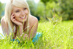 Girl on green field Royalty Free Stock Image