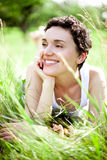 Girl on green field Stock Image