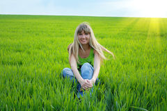Girl  in green field Royalty Free Stock Image