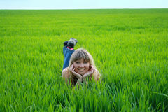 Girl on green field Royalty Free Stock Photo