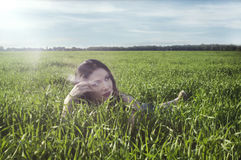 Girl on green field Stock Photography