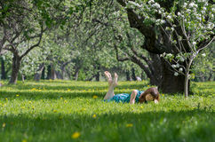 Girl on green field Royalty Free Stock Images