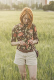 Girl and green field in the evening Royalty Free Stock Photo