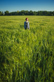 Girl and green field in the morning Royalty Free Stock Photos