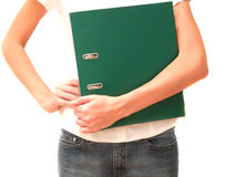 Girl with green folder in hand. A girl with office folder green color close-up Stock Photography