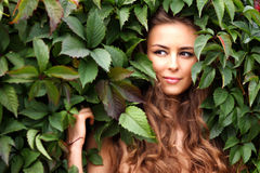 Girl in green foliage Royalty Free Stock Photo