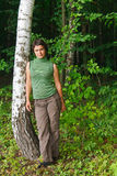 The girl in a green forest. The beautiful girl in a green forest Royalty Free Stock Photo
