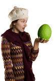 Girl with green fruit Stock Photo