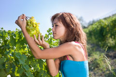 Girl with green grapes Royalty Free Stock Images